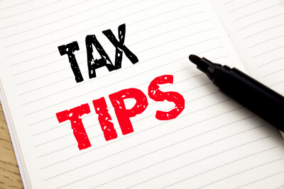 tax tips written in paper